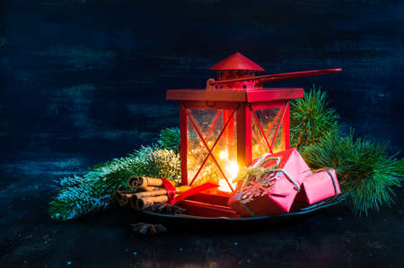 personal ornaments: Christmas time red latern  with candle light and gifts