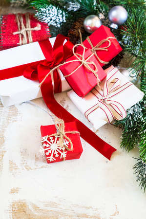 personal ornaments: Christmas presents in rustic style with holiday decorations, selective focus