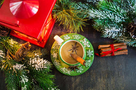 personal ornaments: Christmas time red latern  with candle light,  gifts and cup of coffee with milk with spices like anise star and cinnamon sticks Stock Photo