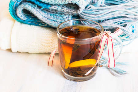tine: Christmas tine tea with lemon and spices like cinnamon sticks and anise star on rustic background