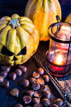 Halloween pumpkin head jack and vintage lantern on wooden background