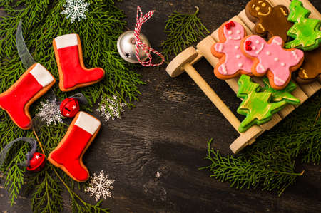 chritmas: Christmas concept with gingerbread man cookie on dark wooden background Stock Photo