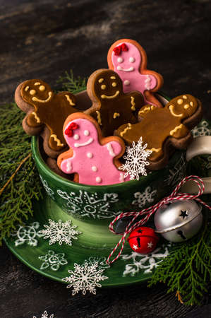 Christmas concept with gingerbread man cookie on dark wooden background Stock Photo