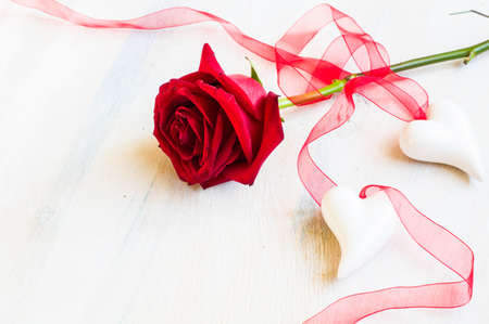 Present for St. Valentines Day  with red ribbon on rustic wooden background with copyspace