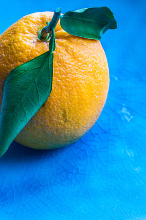 Ripe organic oranges on dark rustic wooden table