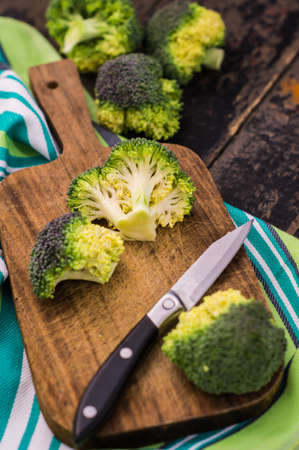 Healthy food concept with fresh broccoli vegetables on dark wooden rustic table  with copyspace