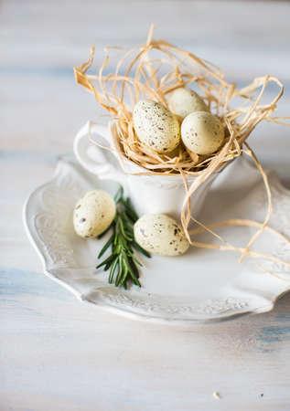 Festive table setting for Easter dinner on wooden rustic table