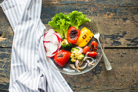 Healthy food concept with grilled fresh organic vegetables on dark wooden table Stock Photo