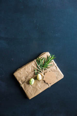 Easter gift boxes with rosemary on dark wooden background Stock Photo