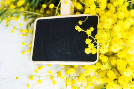 Spring frame with fresh mimosa flowers on wooden background Stock Photo