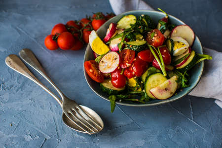 Fresh salad with organic vegetables and boiled eggs for healthy dinner Stock Photo