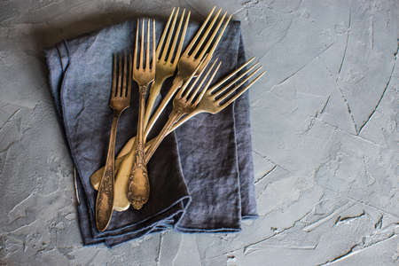 grunge flatware: Vintage silverware on rustic concrete covered grey table