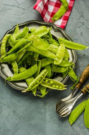 green bean: Organic green peas on rustic background Stock Photo