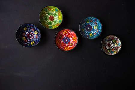 Ceramic bowls on dark wooden background