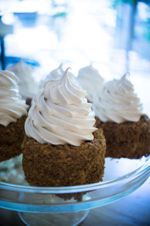Chocolate dessert with vanila cream on the table Stock Photo