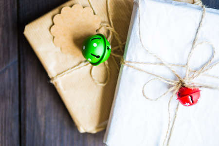 Christmas festive decorated gifts on wooden background, selective focus and copyspace