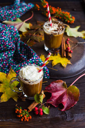 Autumnal concept with bright yellow leaves and cup of coffee  in rustic style with copyspace Stock Photo