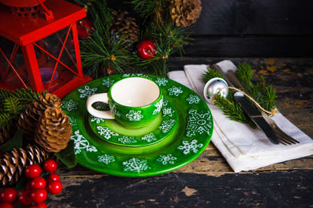 Festive table setting for holiday Christmas dinner on rustic background with copy space