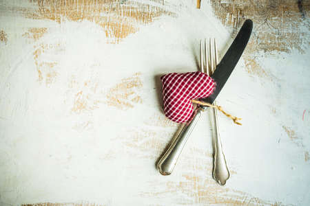 Table setting for holiday dinner in Valentines Day on dark wooden table