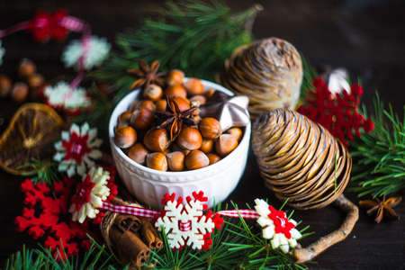 Christmas holiday concept with fir tree, cones, nuts and decoration on rustic background with copyspace