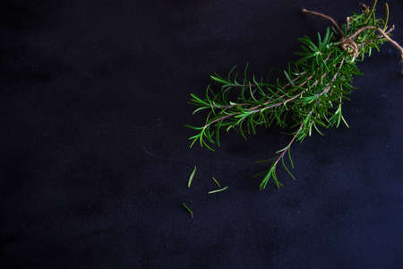 Fresh rosemary spice on rustic background as a cooking concept Stock Photo