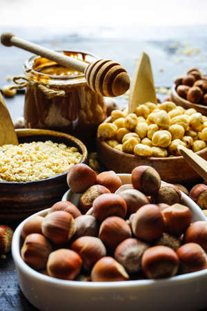 Different types of hazelnuts on dark wooden background with copyspace Stock Photo