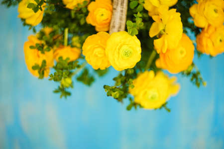 Summer bouquet with bright yellow flowers on rustic blue background stock photo summer bouquet with bright yellow flowers on rustic blue background with copyspace mightylinksfo