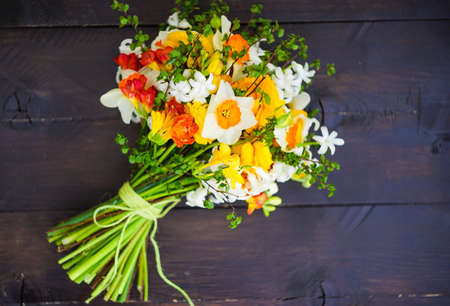 Summer bouquet with bright yellow and white flowers on rustic background with copyspace Stock Photo