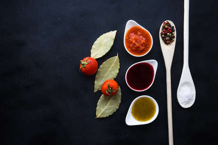 Three the most famous georgian sauces - satsebeli, green and red tkemali on dark background with copy space Stock fotó