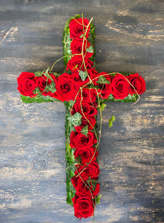 Red roses in floral funerary concept on dark wooden background with copy space Stock Photo