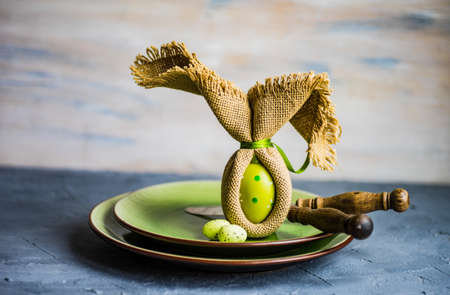 Festive easter table setting with colored eggs and easter bunny concept with copyspace Stock Photo