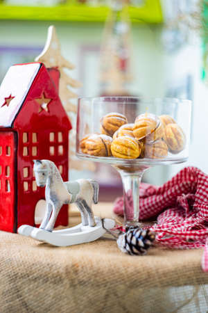 Christmas dessert concept with walnut shaped cookies stuffed with caramel cream