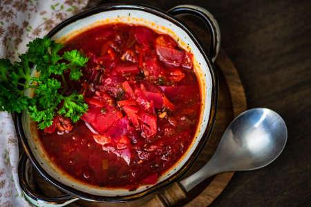Traditional ukrainian beet soup red borscht on wooden table Stock Photo