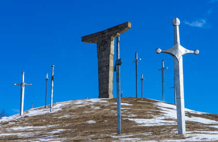 Famous Didgori battle monument with giant swards and sculptures of soldiers close to Tbilisi in Caucasus mountain range