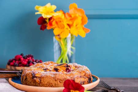 Sweet dessert concept with berries cake  in nice interior Imagens