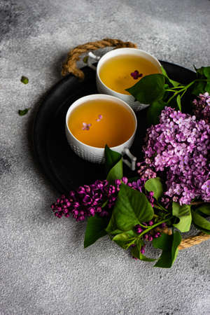 Tea concept with lilac