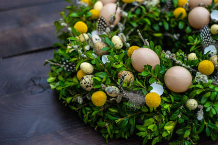 Easter card concept with floral composition with boxwood and colored eggs Stockfoto