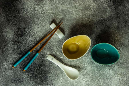 Asian style table setting with chopsticks on grey background with copy space Reklamní fotografie