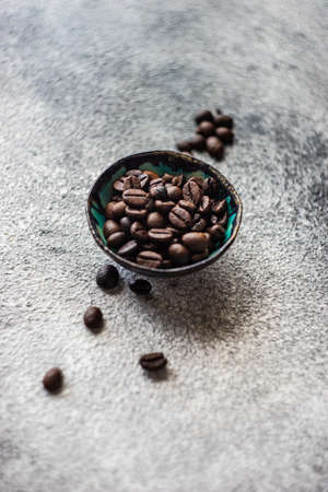 Coffee time concept with  beans in ceramic bowl on concrete background with copy space Reklamní fotografie