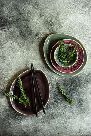Asian style table setting with chopsticks on grey background with copy space Imagens - 124963388