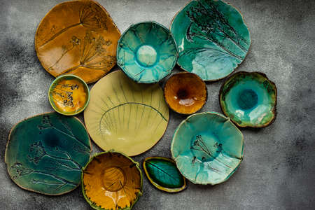 Variety of ceramic plates as a background concet with copy space