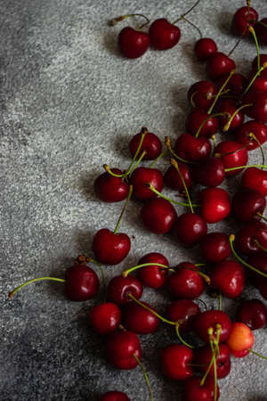 Sweet organic cherries on stone background with copy space Reklamní fotografie
