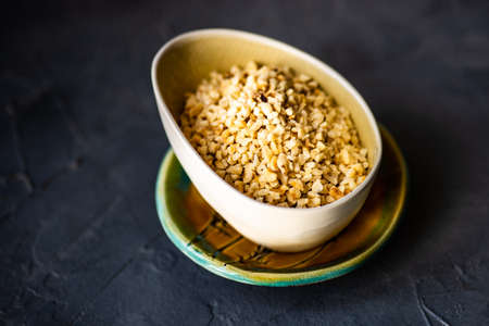 Healthy hazelnuts in a bowl as a healthy food concept with copy space