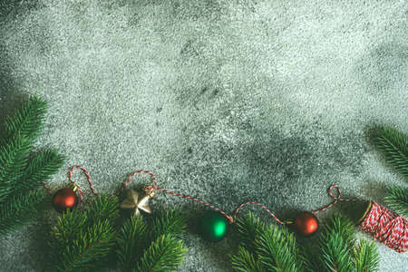 Christmas frame concept with fir tree on rusty stone background with copy space Stock Photo