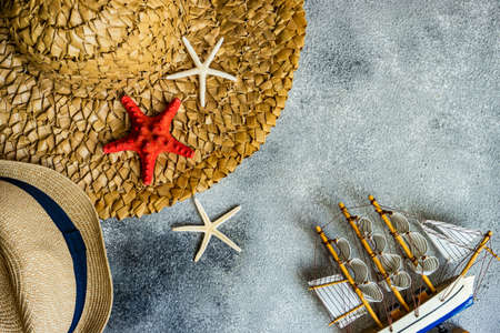 Wide straw hat on rustic background as a holiday concept
