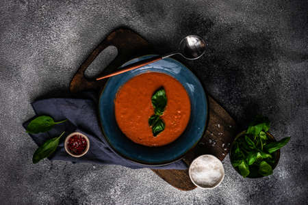 Traditional spanish tomato cream soup Gazpacho in ceramic bowl on rusty stone background with copy space