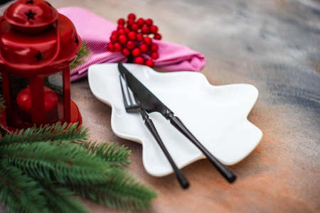 Cutlery set for festive Christmas dinner on concrete background with copy space Archivio Fotografico
