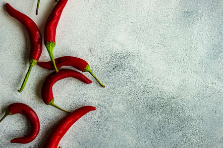 Paprika peppers on stone background as a cooking concept