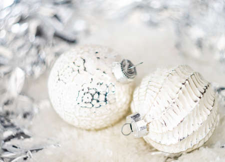 Christmas holiday concept with balls on bright background with copy space