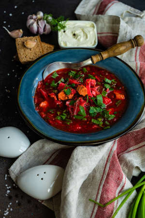 Traditional ukrainian beetroot soup borscht on stone background with copy space